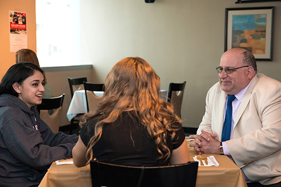 president larry fishman talks to students at the first year student spring dinner
