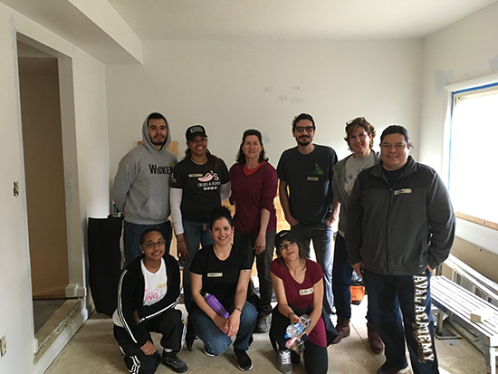 interior design students and instructor at the community build day project
