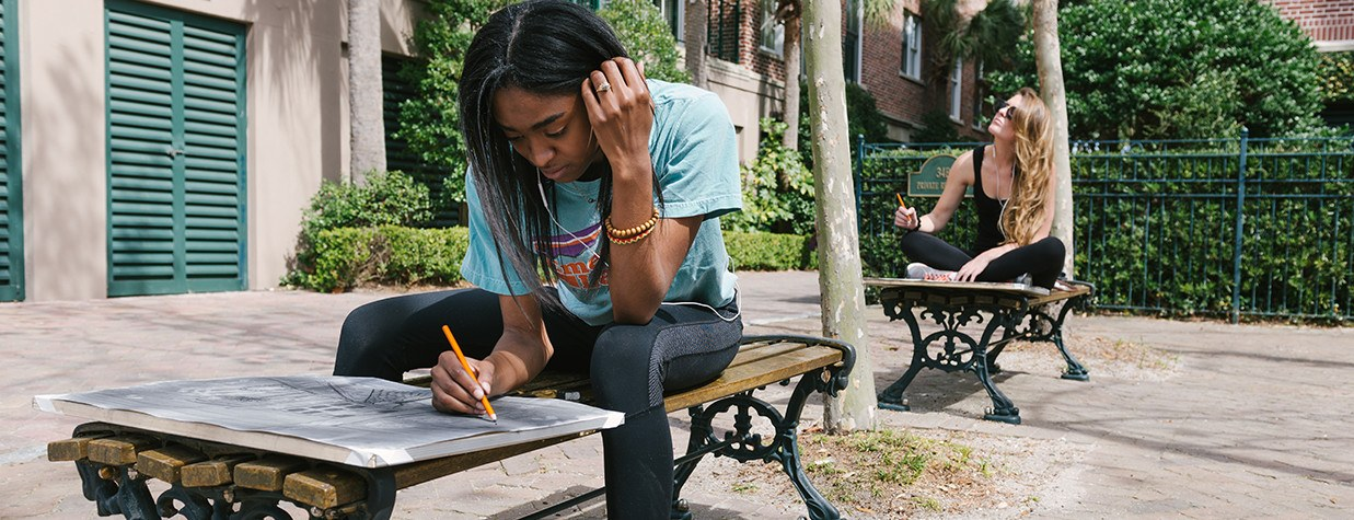 Phoenix Student Working on an Assignment